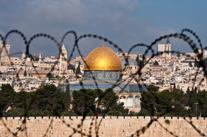 The Dome of the Rock viewed from behind barbed wire.