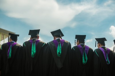 college graduates looking onto horizon