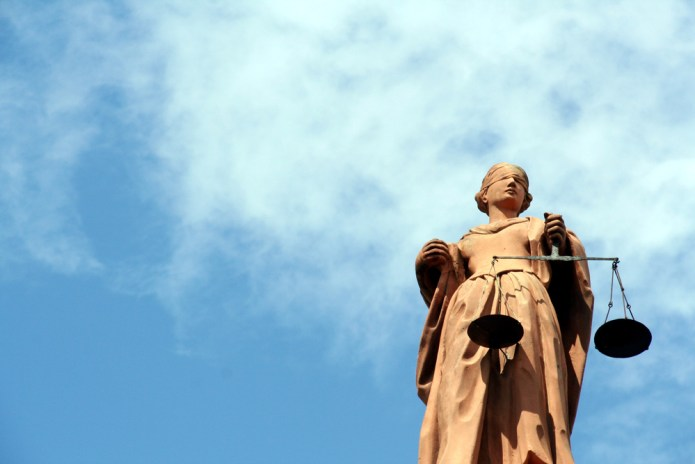 Justicia statue and open sky