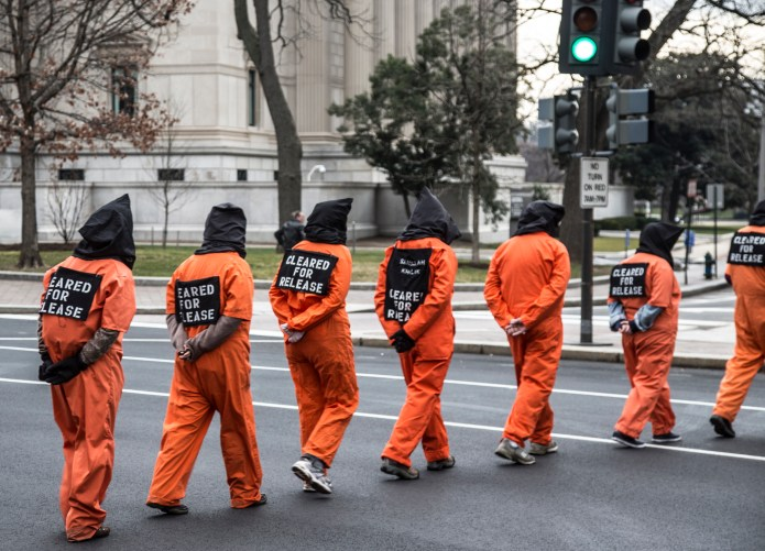 Protesters pose as torture detainees