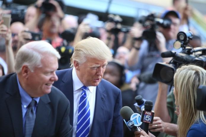 Donald Trump speaks with reporters