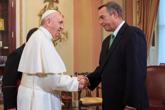 Speaker John Boehner shakes the Pope's hand