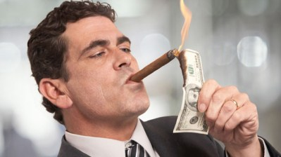Rich CEO lighting cigar with money