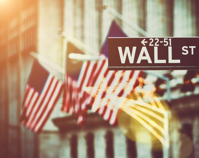 wall-street-sign-american-us-flag