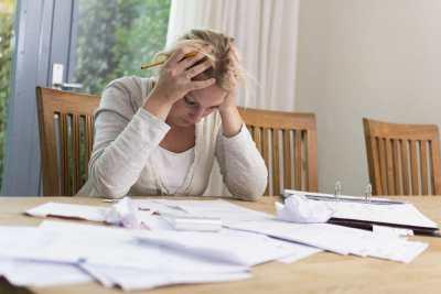 woman-stressed-bills-economy