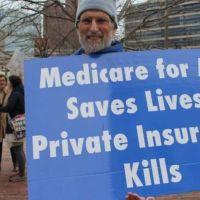 man-holds-sign-medicare-for-all-private-insurance-coronavirus