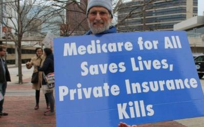man-holds-sign-medicare-for-all-private-insurance-coronavirus