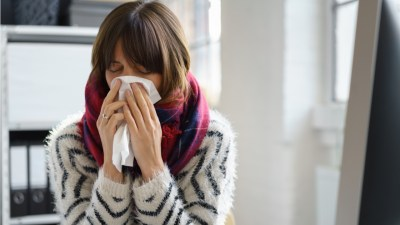 woman-sneezing-service-industry-paid-sick-leave