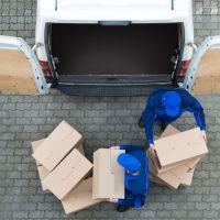 postal workers unloading packages