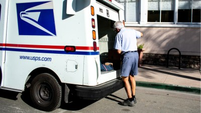A United States Postal Service delivery worker.