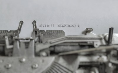 covid-19 conspiracy text typed on paper with old typewriter