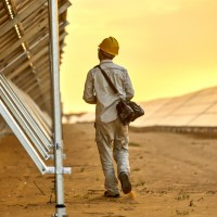 worker at a solar power plant