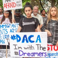 daca protester holding a dreamers sign