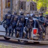 Heavily armed riot police, Portland