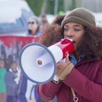 labor - woman organizing a rally