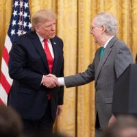 failed covid-19 stimulus package - trump and mcconnell shake hands
