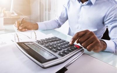 person calculating taxes - taxation - biden tax plan