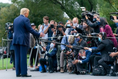 president donald trump speaks to a crowd of press people