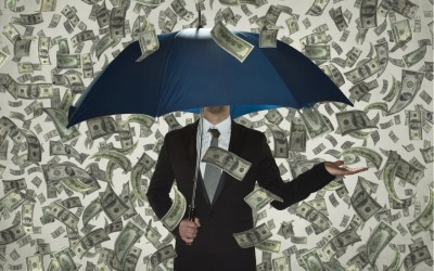money rain over man with umbrella to decipt billionaire wealth gains amid the covid-19 pandemic at one year anniversary of pandemic