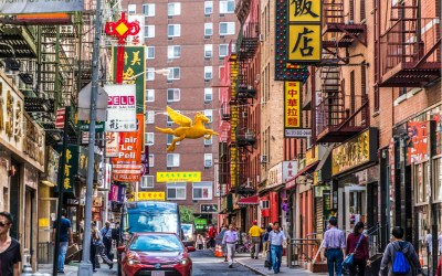 chinatown with shops with chinese letters and pegasus in Chinatown, New York