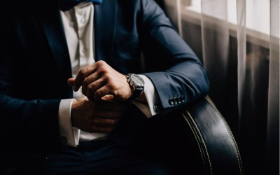 man wearing luxury attire, suit, and watch