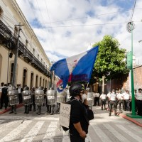 A demonstrator confronts police in Guatemala