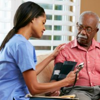 home care worker tending to an elderly man