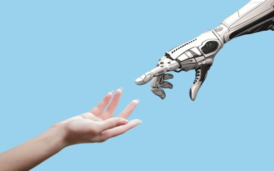 human hand and robot hand reaching for one another