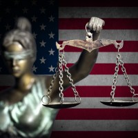 lady justice holding up scale depicting inequality