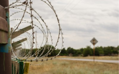 barbed wire fence in a rural town