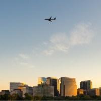 plane flying over office buildings in Arlington, Virginia