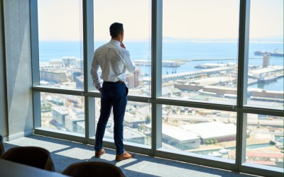 ceo looking out of office window