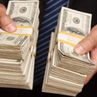 man handing over lots of money