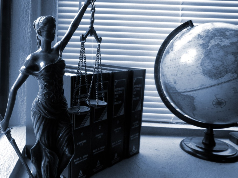 lady justice, law textbooks and globe