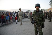 Brazilian peacekeepers and U.S. soldiers distribute food and water in Haiti's capital.  / Credit:UN Photo/Sophia Paris