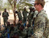 A U.S. Marine debriefs a Malian counter-terrorism unit after mission rehearsals as part of Operation Flintlock 2010. / Credit: Max Blumenfeld/U.S. AFRICOM