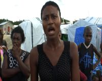 Residents of the Sentra Park Camp listen as Marie Lucie Martel, 21, talks. / Credit:Haiti Grassroots Watch