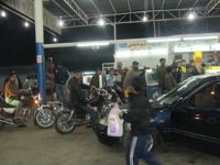 Gazans storm a petrol station in search of fuel. / Credit:Pam Bailey