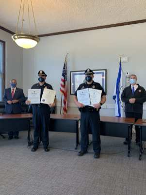 From left: Sen. Bruce Tarr, Lt. Jonathan Hubbard, Officer Brian Murphy and Rep. Brad Hill. (Photo courtesy of the Ipswich Police Department)