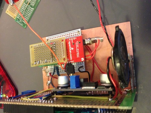 Top view of Si4707 Weather Band Radio Project. The power supply sits on the back of the LCD/keypad support board and the weather band sits sandwiched between the TAUTIC dev board and daughter-protoboard. The speaker was just thrown in there for quick testing.