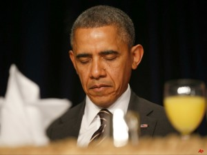 QUIET MOMENT — President Obama bows his head in prayer at the National Prayer breakfast.