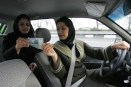 An Iranian woman pays a female taxi driv