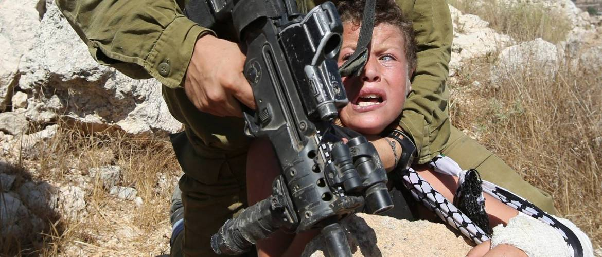 150830073831-01-israeli-soldier-arrests-palestinian-boy-super-tease