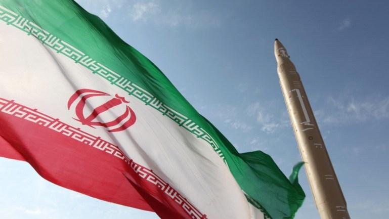 141125164236-iran-nuclear-talks-flag-missile-super-169