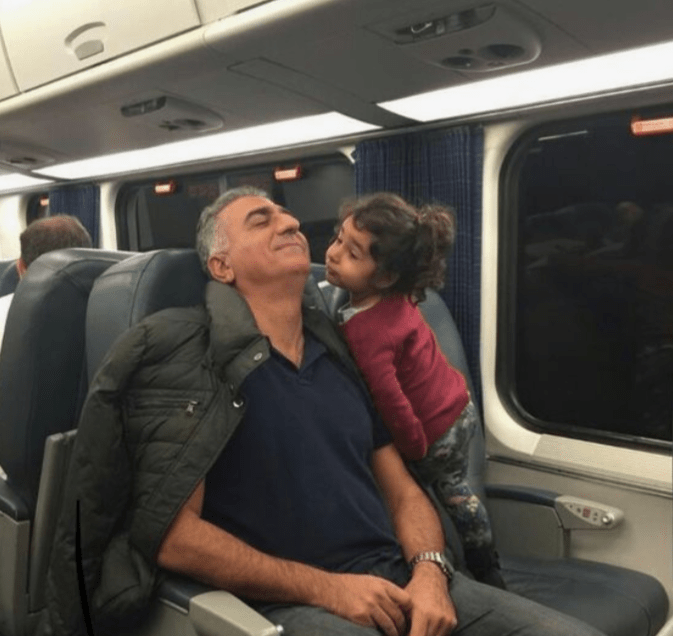 Reza Pahlavi with his niece Aryana Pahlavi in a train on the way to New York