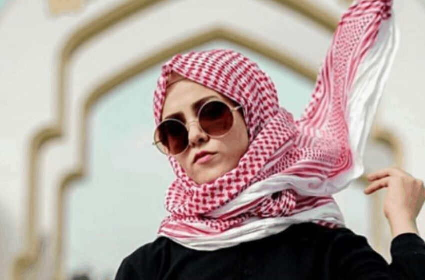 Iraqi woman with black top with Arabic writing2