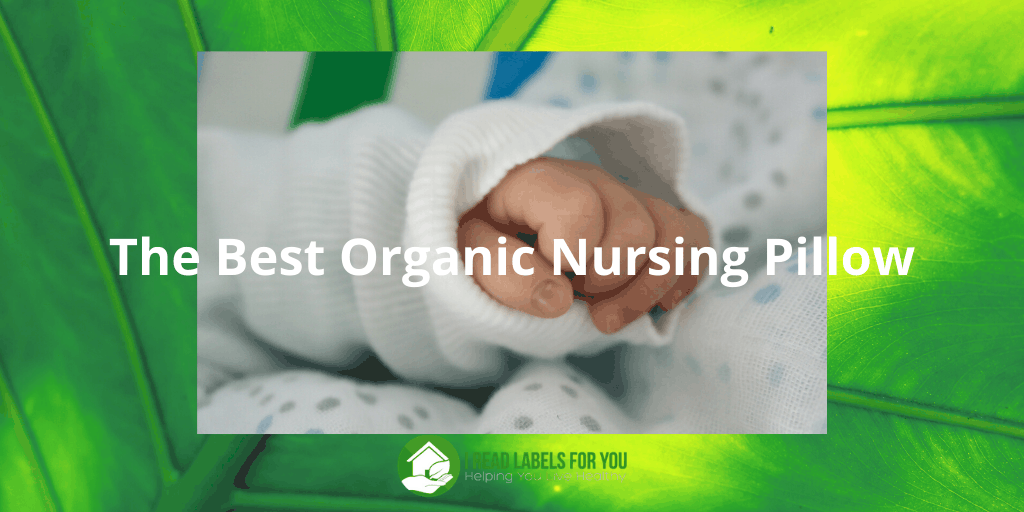 The Best Organic Nursing Pillow. A photo of a hand of a baby lying on a baby feeding pillow.