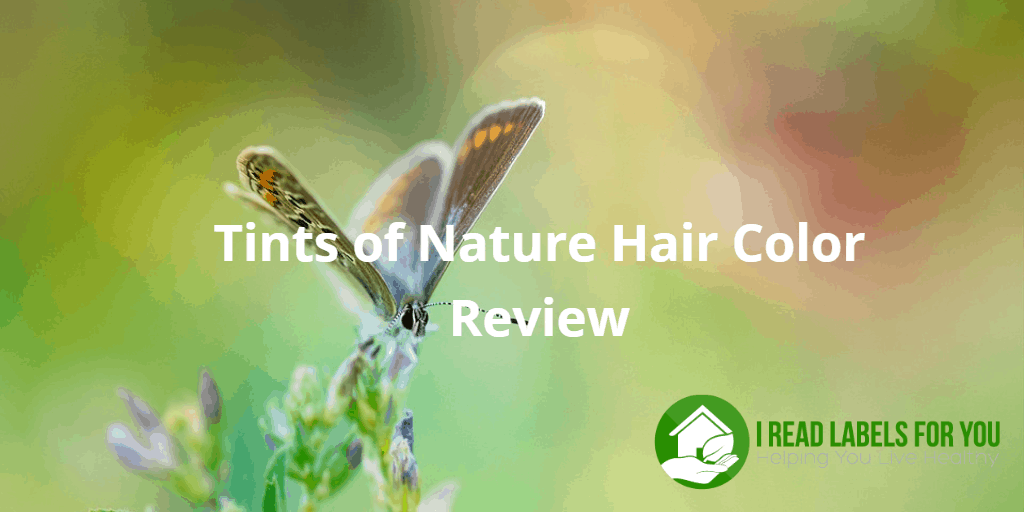 Tints of Nature Hair Color Review. A photo of a brown butterfly on a flower.