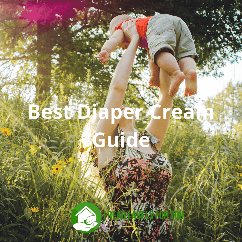Best Diaper Cream Guide for severe diaper rash treatment. A photo of a woman lifting up a baby.