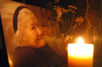 5.12.08 - Fort Scott, Kan. - A photo of the late Irena Sendler is lit by candlelight in the window of the Lowell Milken Center Monday night in Fort Scott. Sendler, a Polish woman who rescued more than 2,500 Jews from the Warsaw, Poland ghetto during the Holocaust, died May 12 in Poland. She had suffered from a long bout of pneumonia. The Lowell Milken Center in Fort Scott is home to the Life in a Jar project, which features the heroics and life of Sendler. The photograph of Sendler was taken the beginning of May.